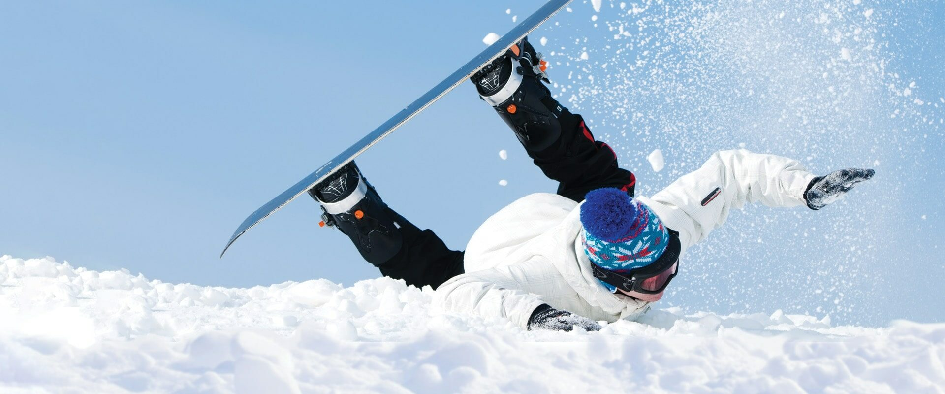 Photo of male snowboarder falling