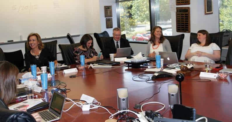 Photo of JFLAC participants preparing for the hot topics project presentation.