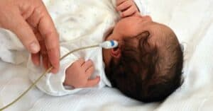 Close-up photo of newborn hearing test