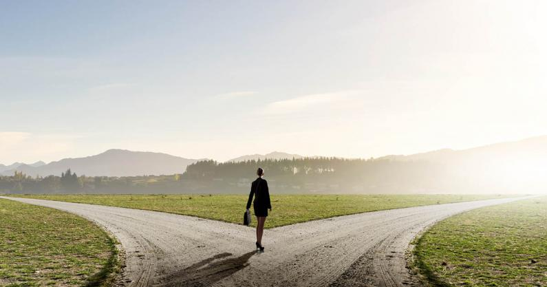 Photo of a business woman at a crossroads