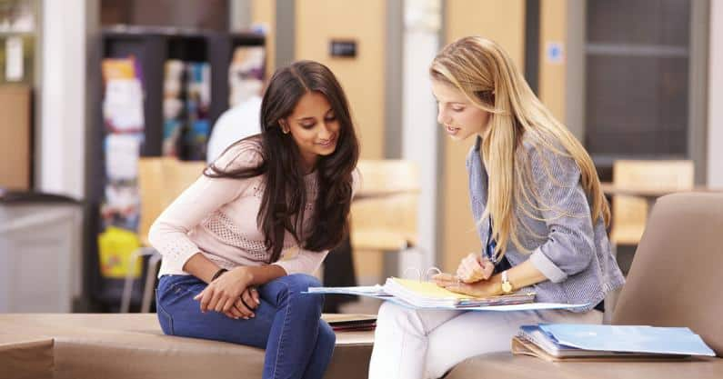 Photo of one woman mentoring another