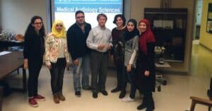Photo of the first cohort of audiology students in the Medical Audiology Sciences program at the American University of Beirut with Visiting Professor James W. Hall III, PhD, during an auditory electrophysiology class in January of 2016.