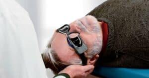 Photo of an older man receiving vestibular testing