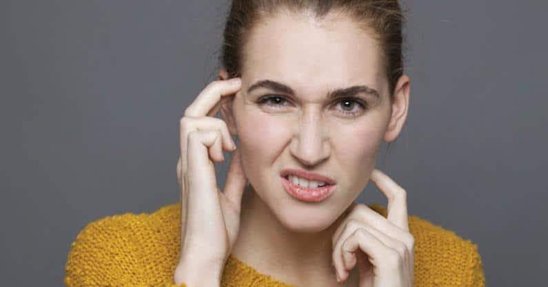 Photo of woman having difficulty understanding