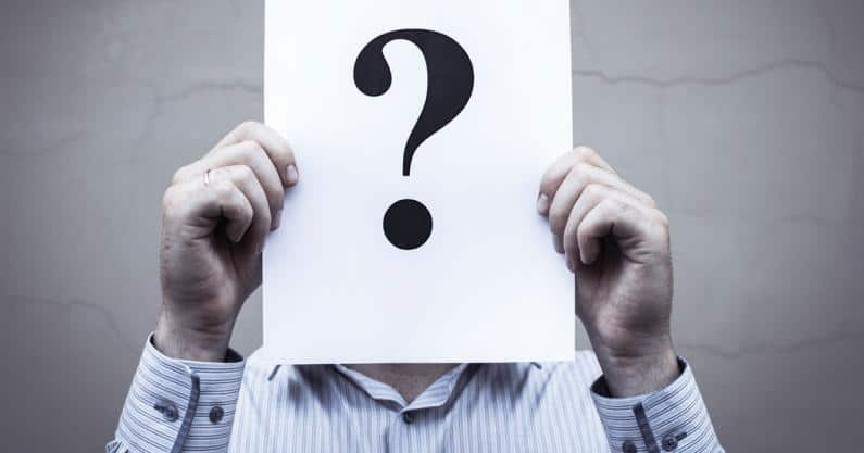 Photo of anonymous man holding paper with question mark