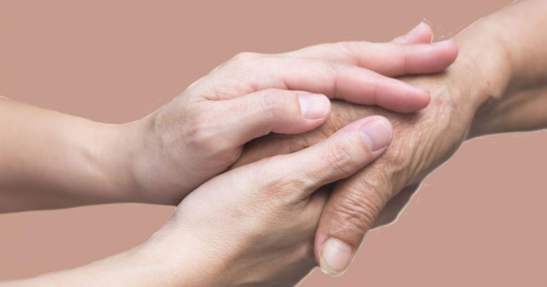 Photo of one person's hands holding the another