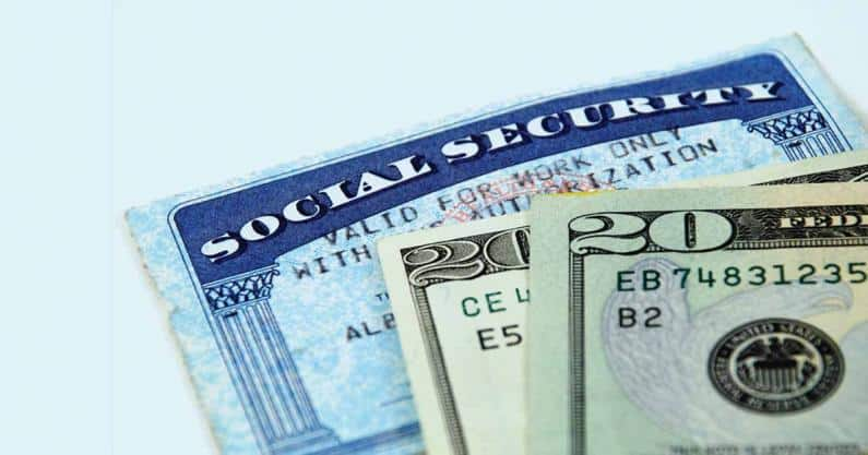 Close-up of of social security card and money