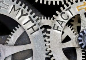Close up image of interacting gears with Myth and Fact represented