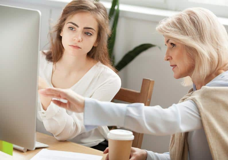 New professional being mentored by seasoned audiologist