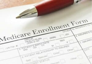 Close-up photo of pen and Medicare enrollment form