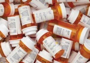Close-up photo of pile of prescription pill bottles