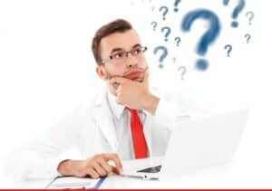 Photo of Audiologist with laptop questioning things