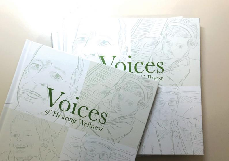 Photo of a group of Voices of Hearing Wellness books