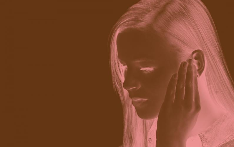 Photo negative of girl who is hard of hearing