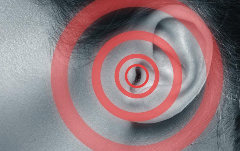 Close-up photo of an ear with tinnitus issues