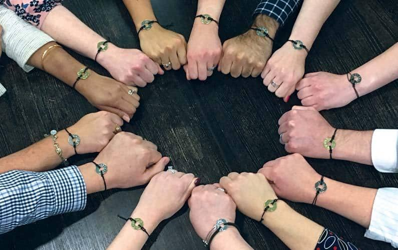 Close-up of the winning recipients bracelets on their wrists