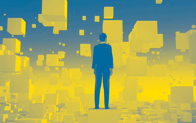 Photo illustration of business man standing on cube with floating cubes surrounding him