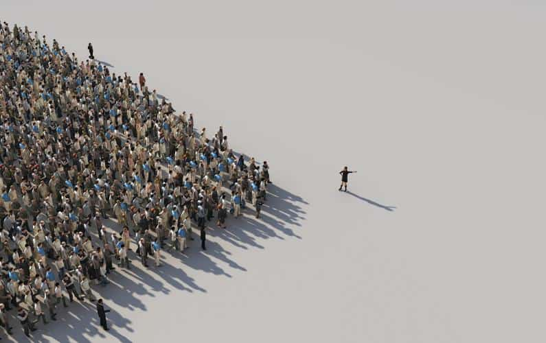 Photo of a crowd of people with a leader leading the way