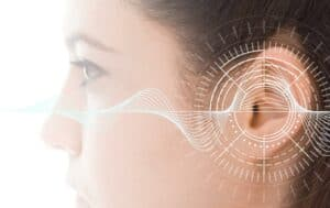 Close-up illustrated photo of a woman with hearing analysis