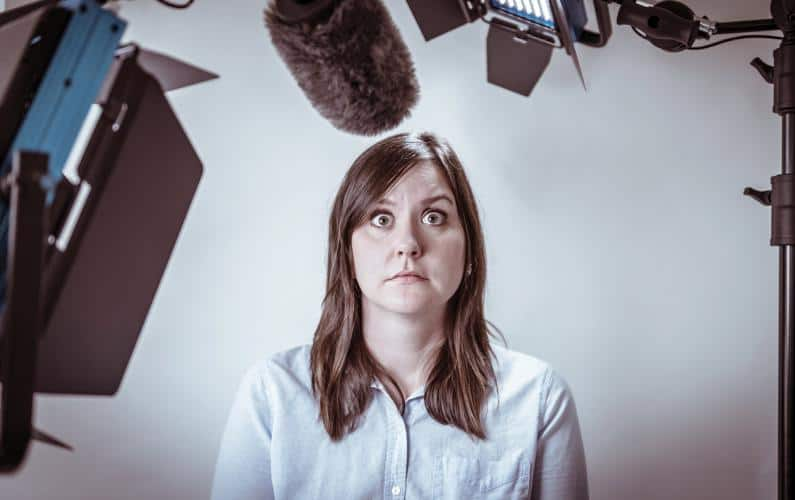 A photograph of a woman appearing to have stage fright during a televised interview