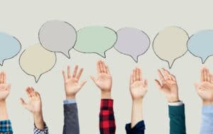 Combined photo of volunteering hands with illustrated speech bubbles overhead