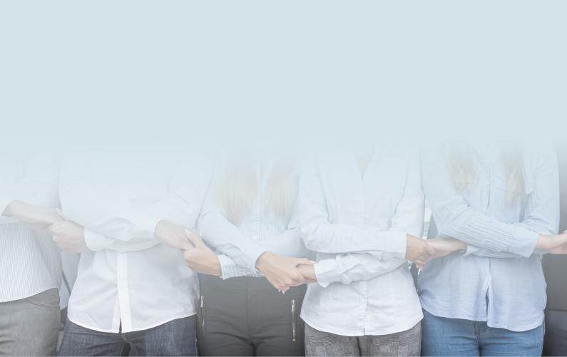 Photo of a group of professionals side by side holding hands