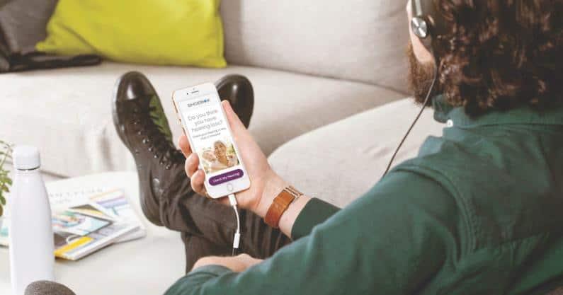 Man operating ShoeBox app on phone