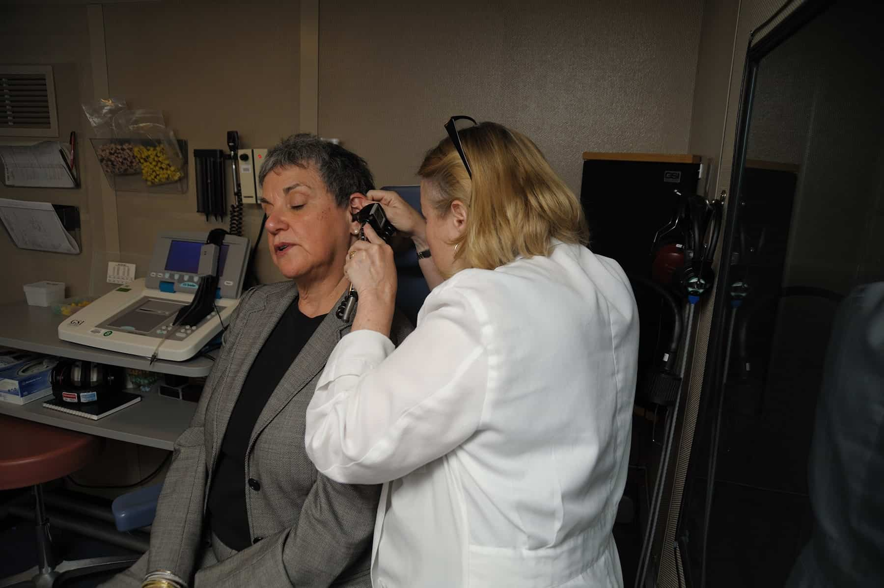 Audiologist Performing Hearing Exam on Older Female Patient