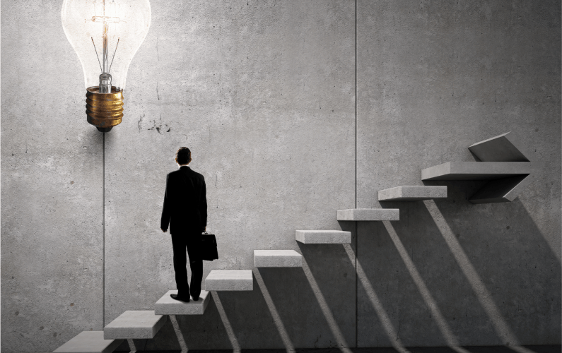Abstract photo of business man looking up at an idea while standing on inclining staircase