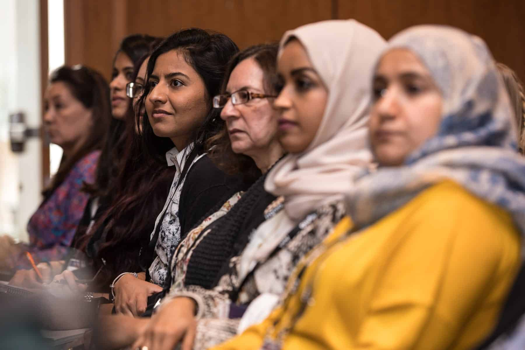 Academy conference members listening during conference presentation