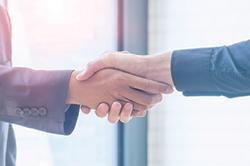 Photo of 2 men shaking hands