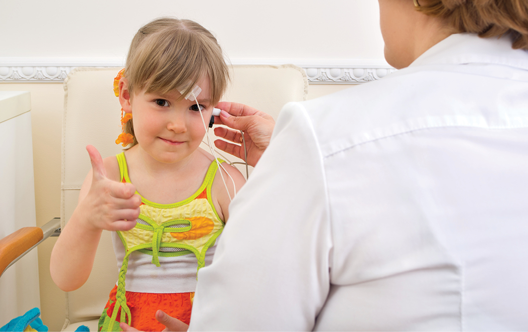 Hearing test on young girl image