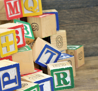 Wooden alphabet blocks for young children